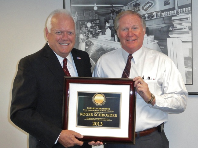 Roger Schroeder receives plauque from Bob Reeves