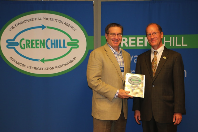 Scott Martin of Hillphoenix receives a Store Certification Excellence Award from Tom Land of the EPA GreenChill Program.