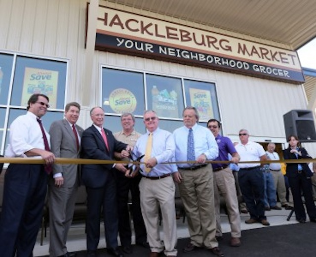 Alabama Gov. Robert Bentley and other state and local officials cut a ribbon to open the new Hackleburg Market in Hackleburg in mid-2015. (Photo: Jamie Martin/Alabama Governor's Office)