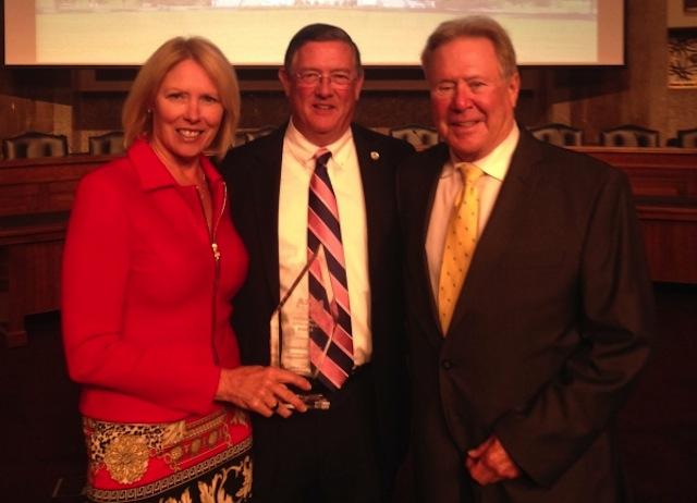 Mary Pat Woodmansee, Peter Larkin and Tom Woodmansee.