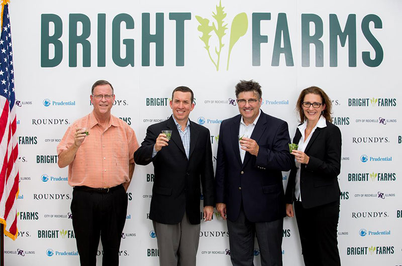 Rochelle Mayor Chet Olson, left, and BrightFarms CEO Paul Lightfoot, second from left, were among those who celebrated the grand opening and first harvest at BrightFarms' Chicagoland greenhouse.