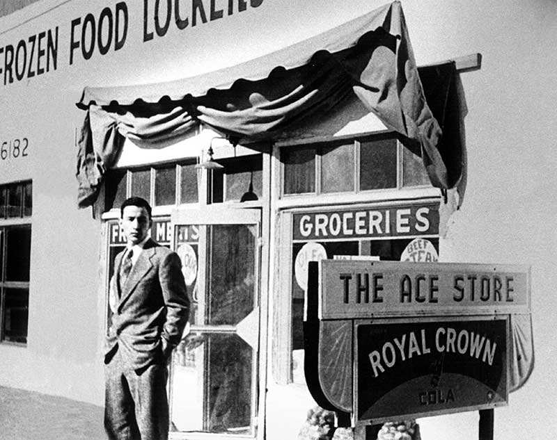 Joe Baca in front of the family's Ace Food Store. Bueno Foods started out as a small neighborhood grocery store, but after big stores came in it was forced to innovate and Bueno Foods was born.