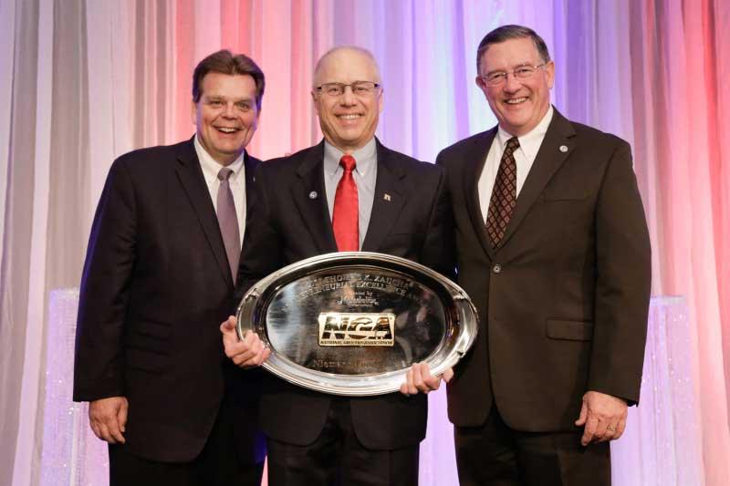 Rick Brindle, Mondelez International; Rich Niemann Jr., Niemann Foods Inc.; and Peter J. Larkin, NGA.