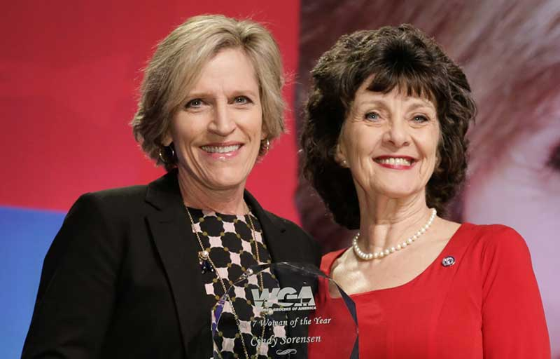 2017 Woman of the Year Cindy Sorensen of the Midwest Dairy Association with Lorelei Mottese, chair of the Women Grocers of America.