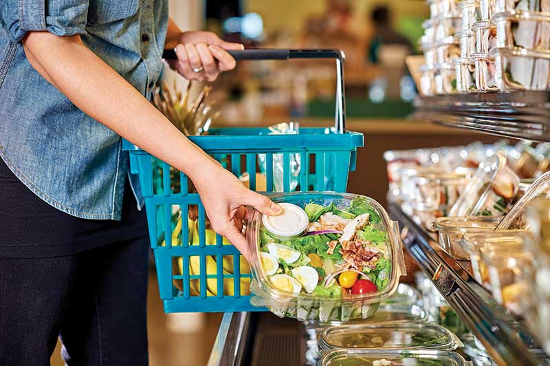 Woman-Buying-Prepackaged-Salad