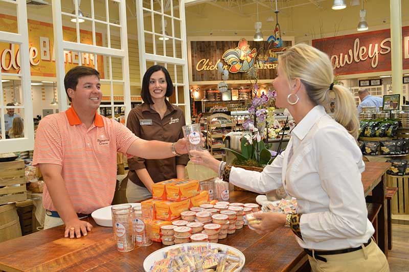 Community-Table-host-with-guests---courtesy-Lowes-Foods