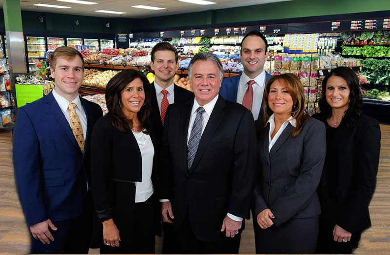 Family members and staff of Inserra Supermarkets recently gathered to announce the launch of the locally grown produce program.