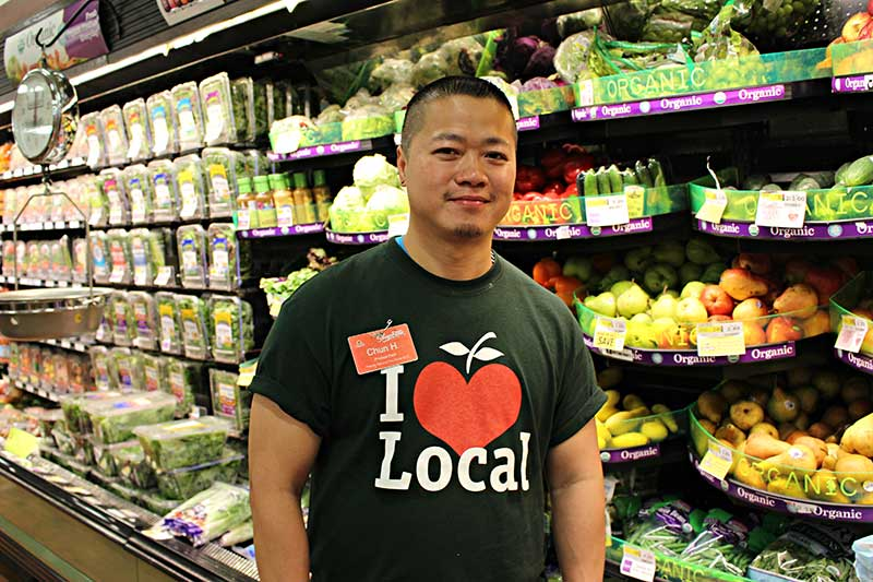 Produce staffer Chun Hung in the Locally Grown department of ShopRite's Cherry Hill Township, New Jersey, store.