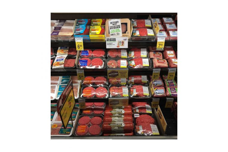 The plant-based Beyond Burger, stocked in the meat case at a Safeway store.