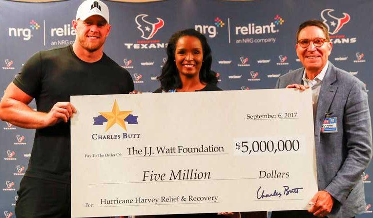 NFL star JJ Watt with Winell Heron and Scott McClelland, H-E-B.