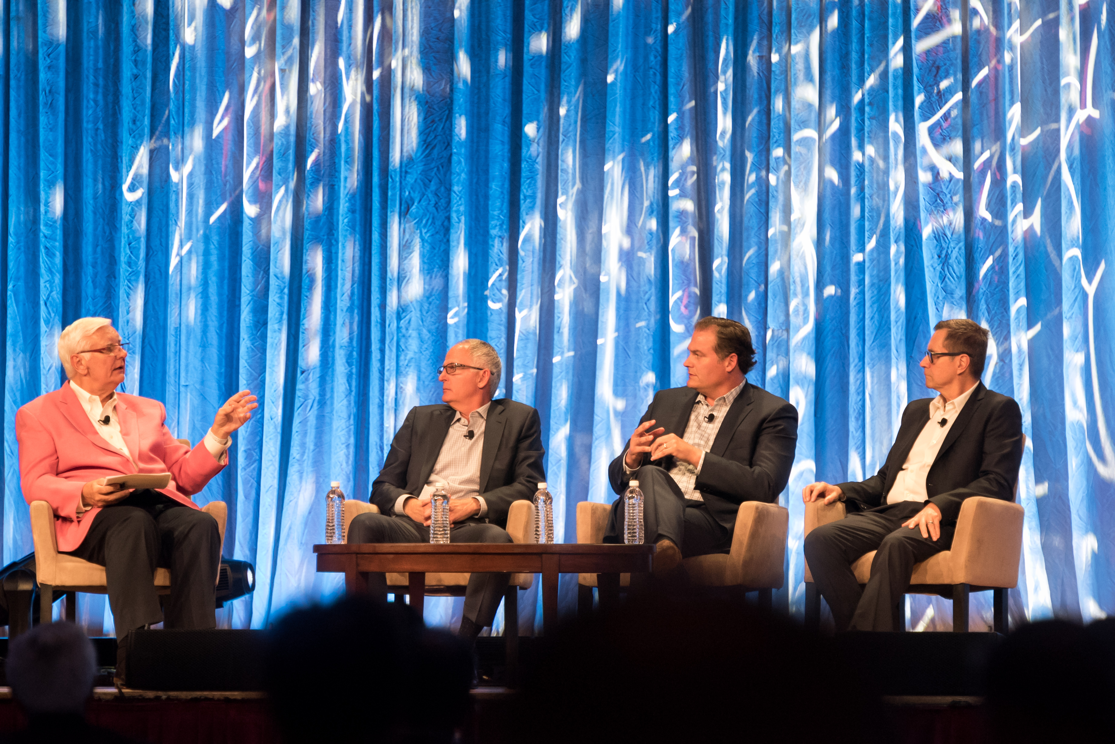 From left: Moderator Thom Blischok; Greg Wasson, former CEO, Walgreens Boots Alliance; Justin Dye, former chief administration officer, Albertsons Cos.; and Bob Mariano, former chairman, president and CEO, Roundy's.