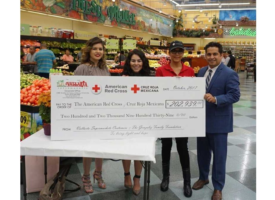 Check presentation to American Red Cross and Cruz Roja Mexicana. Left to right: Ruby Martinez, marketing manager, and Diana Garci, marketing coordinator, Vallarta; Norma Vega, American Red Cross; and Castillo.