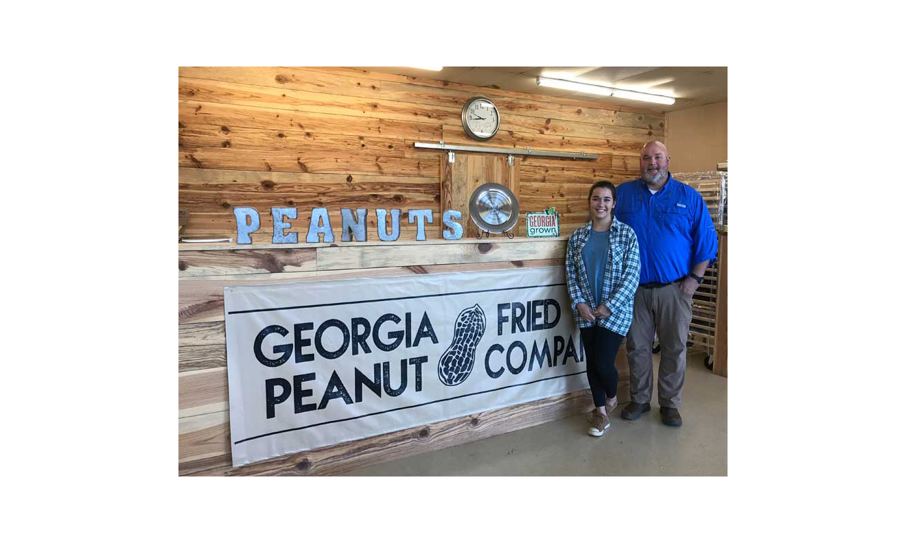 John West and his daughter, Taylor. She runs Georgia Fried Peanut Co. along with three other employees.