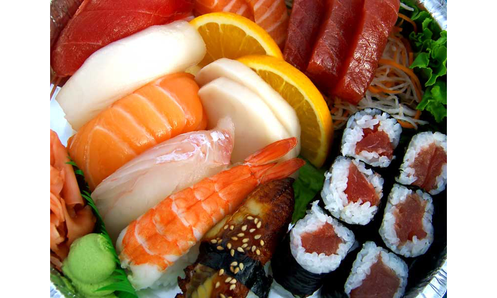 A plate of sushi and sashimi