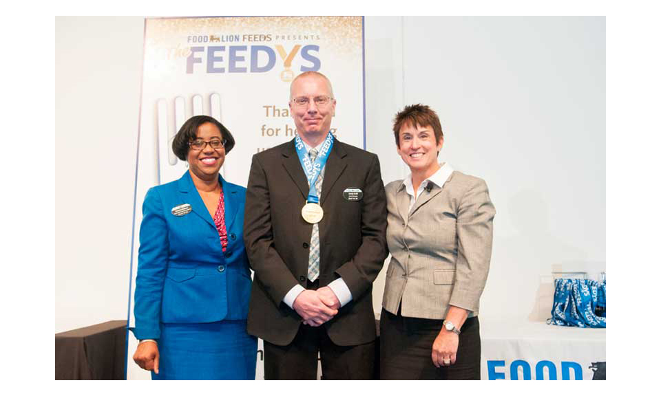 Emma Inman, director of external communications and community relations; Andy Grill, store manager Food Lion Store# 424 in Banner Elk, North Carolina; Meg Ham, president, all of Food Lion.