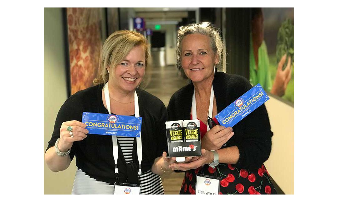 Mame's Burritos representatives from Denver, Colorado, hold their organic burritos and congratulatory cards.