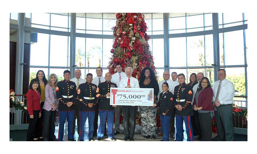 Stater Bros. President and CEO Pete Van Helden (center) and Stater team members present the company's 2017 donation to members of the U.S. Marine Corps for their Toys for Tots drive.