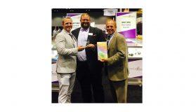 Food Freshness Card Inventors RJ Hassler and Rick Hassler accept the Innovation Award from John Toner (center), VP of United Fresh.