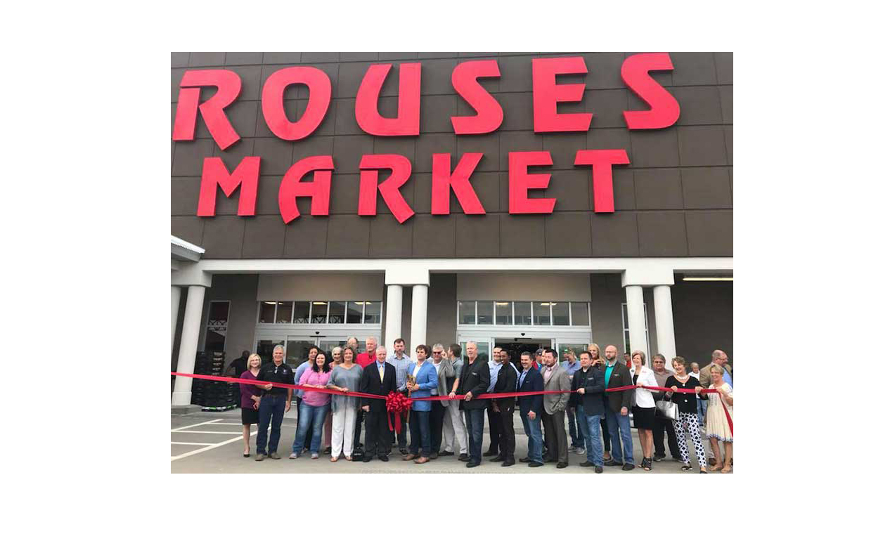 The ribbon-cutting at the new Sulphur store