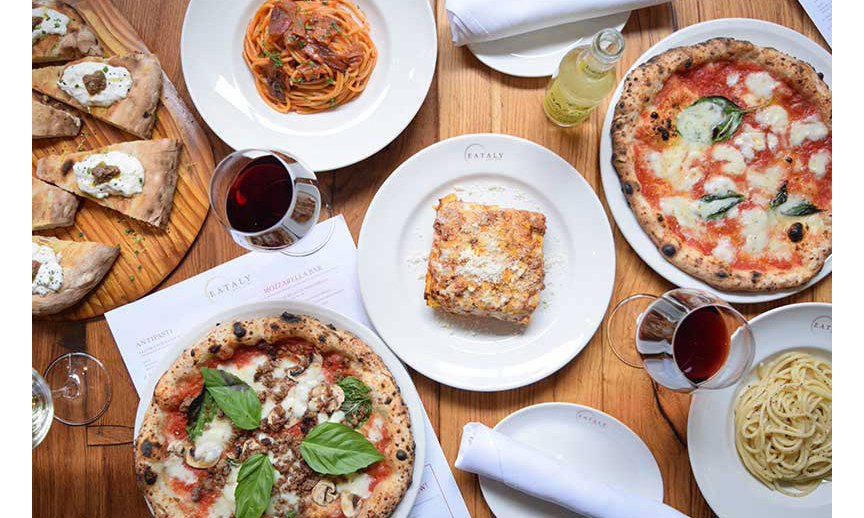 A table holding Italian dishes