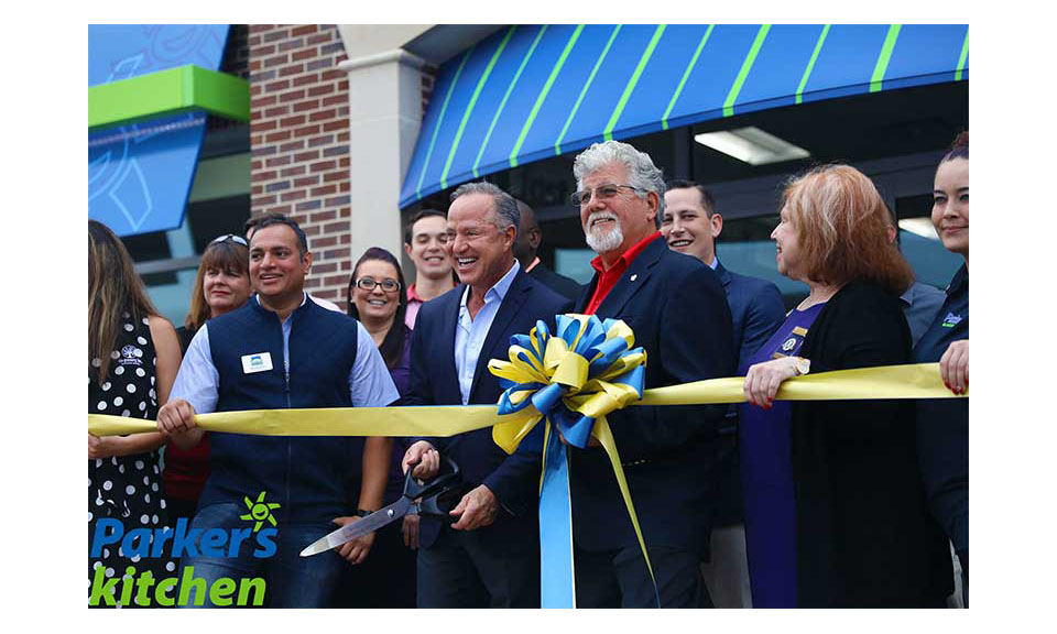 Parker's President and CEO Greg Parker, center, and Pooler Mayor Mike Lamb, right of center, cut the ribbon at the new store.