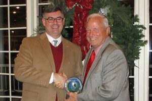 NGA EVP Greg Ferrara, left, receives the Government Affairs Partnership Award from Jon McCormick, president and CEO of RGA/KFDA.