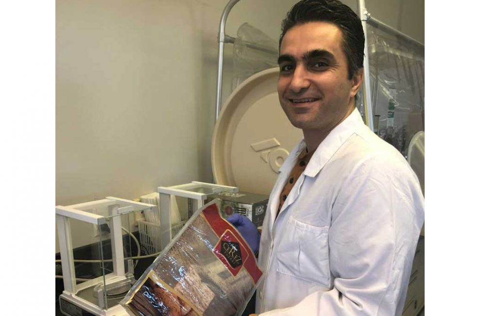 Mehdi Hashemi, a Ph.D. student in the Food Science and Technology program of Texas A&M's Department of Nutrition and Food Science, holds a bag of dried sumac, which is used as a spice in Middle Eastern countries. (Texas A&M AgriLife Research photo)