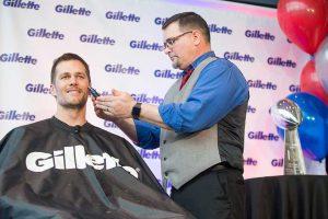 Tom Brady getting a shave