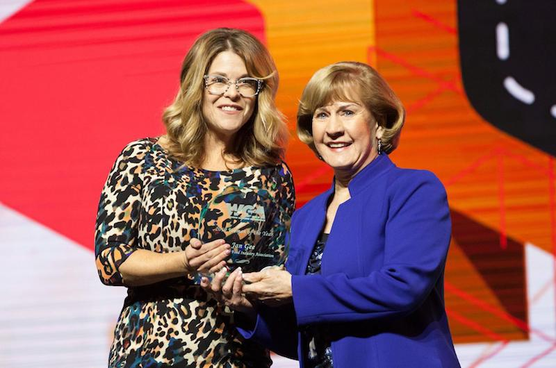 Jan Gee, Washington Food Industry Association, right, accepts the Woman of the Year Award from Shiloh Costello, CGA Foundation.