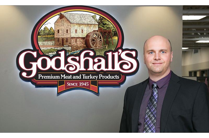 Ron Godshall with logo