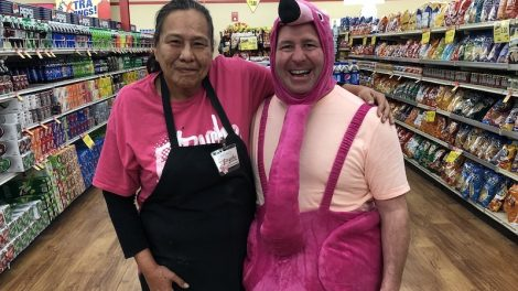 Cancer survivor and Buche Foods employee Patrice with RF Buche in a flamingo costume.